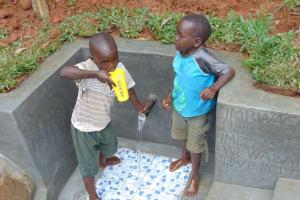The Water Project: Bumira Community, Imbwaga Spring -  Enjoying A Fresh Drink