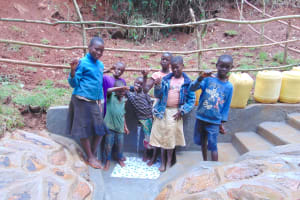 The Water Project: Kisasi Community, Edward Sabwa Spring -  Kids Pose With The Spring
