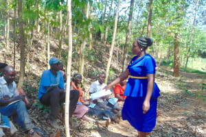The Water Project: Shivembe Community, Murumbi Spring -  Trainer Karen Opens The Event