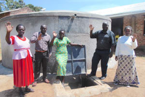 The Water Project: Kosiage Primary School -  Staff Wave From Rain Tank