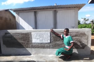 The Water Project: Mwichina Primary School -  A Pupil Poses With The New Latrines