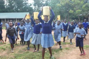 The Water Project: St. Martin's Primary School -  Students Carrying Water