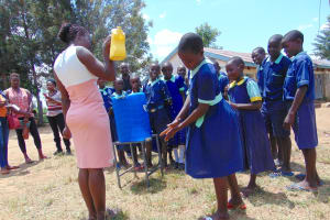 The Water Project: Mukama Primary School -  Handwashing Practice Using A Leaky Tin