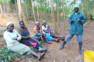 The Water Project: Shivembe Community, Murumbi Spring -  Volunteer Demonstrates Toothbrushing