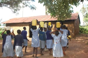 The Water Project: St. Martin's Primary School -  Students Deliver Water To The Kitchen