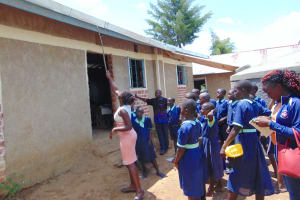 The Water Project: Mukama Primary School -  Pointing Out The Gutter System To Students