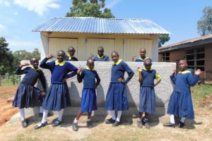 The Water Project: Kosiage Primary School -  Girls Pose With New Latrines