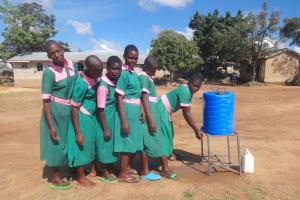 The Water Project: Mwichina Primary School -  Girls Use A Handwashing Station