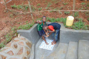 The Water Project: Bumira Community, Imbwaga Spring -  Thumbs Up And Smiles For Clean Water