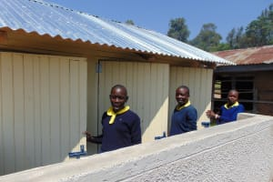 The Water Project: Kosiage Primary School -  Girls At Doors To Their New Latrines
