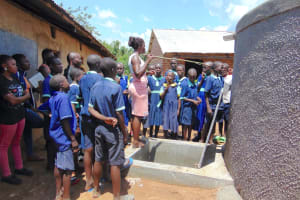The Water Project: Mukama Primary School -  Students Learn About The Rain Tank