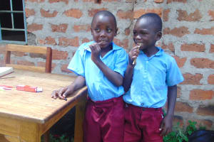 The Water Project: Kipchorwa Primary School -  Pupils Mike And Jeremy Demonstrate Toothbrushing Using A Twig