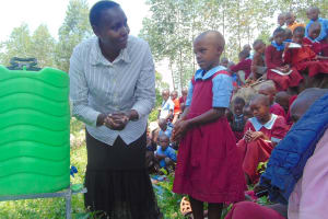 The Water Project: Kipchorwa Primary School -  Health Club Patron Demonstrates Handwashing