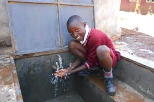 The Water Project: Ebukhuliti Primary School -  Enjoying Rain Tank Water