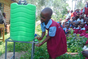 The Water Project: Kipchorwa Primary School -  Student Purity Demonstrates Handwashing