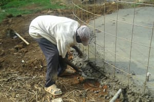 The Water Project: Kamimei Secondary School -  Aligning Rebar With Foundation