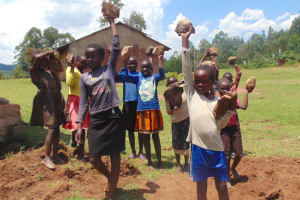 The Water Project: Kipchorwa Primary School -  Pupils Deliver Stones For Contruction