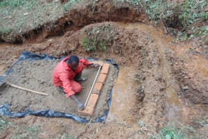 The Water Project: Kisasi Community, Edward Sabwa Spring -  Measuring The First Bricks