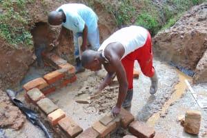 The Water Project: Kimarani Community, Kipsiro Spring -  Wall Construction