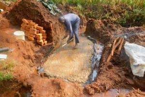 The Water Project: Shikhombero Community, Atondola Spring -  Laying Foundation