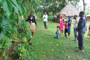 The Water Project: Buyangu Community, Mukhola Spring -  Leaky Tin Demonstration