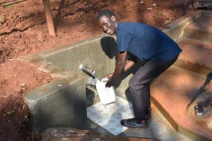 The Water Project: Shikhombero Community, Atondola Spring -  Easy Collecting Water