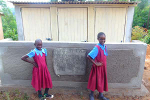 The Water Project: Kipchorwa Primary School -  Girls Pose With Latrines