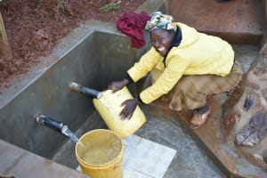 The Water Project: Busichula Community, Marko Spring -  Rinsing Containers And Fetching Water At The Same Time Is A Breeze