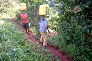 The Water Project: Shikhombero Community, Atondola Spring -  Carrying Clean Water Home