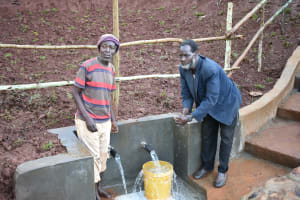 The Water Project: Busichula Community, Marko Spring -  Older Men Experiencing The Spring
