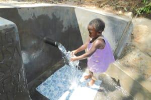 The Water Project: Imbinga Community, Imbinga Spring -  Getting A Fresh Drink