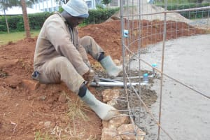The Water Project: Ebukhuliti Primary School -  Artisan Adjusts Tap And Drainage System