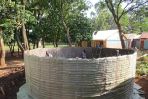 The Water Project: St. Joseph's Lusumu Primary School -  Artisans Work Inside Sugar Sack Covered Tank