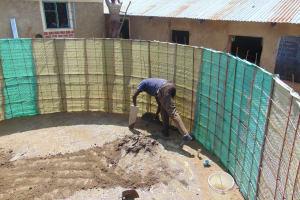The Water Project: Mukama Primary School -  Interior Rain Tank Cement Begins