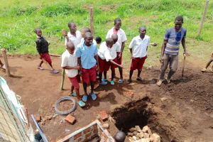 The Water Project: Mulwanda Mixed Primary School -  Students Throw Stones Into Soak Pit