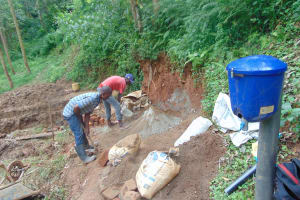 The Water Project: Bumira Community, Imbwaga Spring -  Mixing Cement
