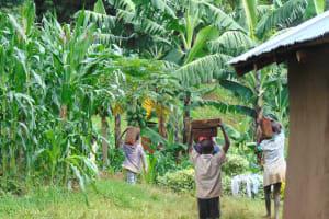 The Water Project: Kimarani Community, Kipsiro Spring -  Kids Help Carry Bricks To The Construction Site
