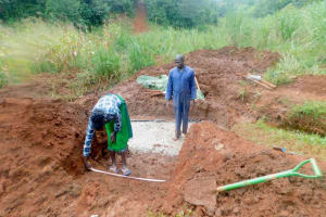 The Water Project: Shikhombero Community, Atondola Spring -  Field Oddicer Elvin Confirms Stair Measurements