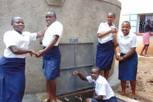The Water Project: Kamimei Secondary School -  Girls Pose With Rain Tank