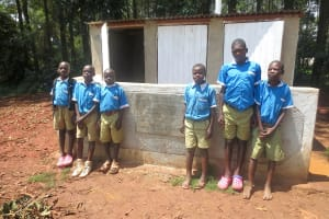 The Water Project: St. Joseph's Lusumu Primary School -  Boys Stand With New Latrines