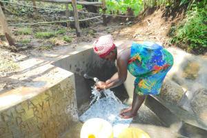 The Water Project: Imbinga Community, Imbinga Spring -  Enjoying The Spring Water