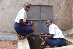 The Water Project: Kamimei Secondary School -  Girls At The Rain Tank Tap