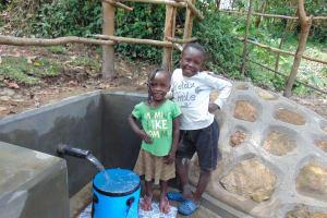 The Water Project: Buyangu Community, Mukhola Spring -  Smiling Kids At Spring