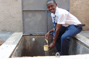 The Water Project: Kamimei Secondary School -  Student Getting A Drink