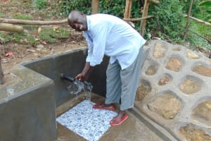 The Water Project: Buyangu Community, Mukhola Spring -  Flowing Water