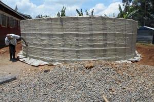 The Water Project: Ebukhuliti Primary School -  Tying Sugar Sacks To Rebar