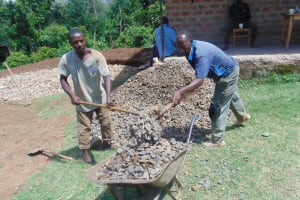 The Water Project: Kipchorwa Primary School -  Shoveling Gravel