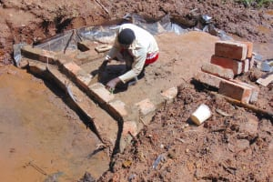 The Water Project: Jivovoli Community, Magumba Spring -  Bricklaying