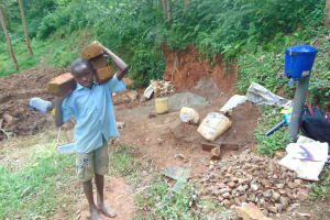 The Water Project: Bumira Community, Imbwaga Spring -  A Child Carries Bricks To The Site