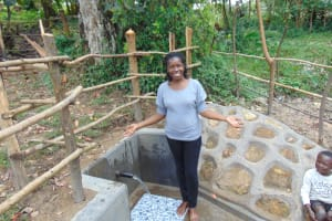 The Water Project: Buyangu Community, Mukhola Spring -  Field Officer Christine Celebrates The Spring